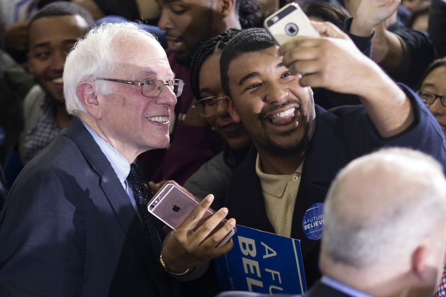 Democratic presidential candidate Sen. Bernie Sanders, I-Vt., takes photos during a rally at Morehouse College, on Tuesday, Feb. 16, 2016, in Atlanta. (AP Photo/Evan Vucci)