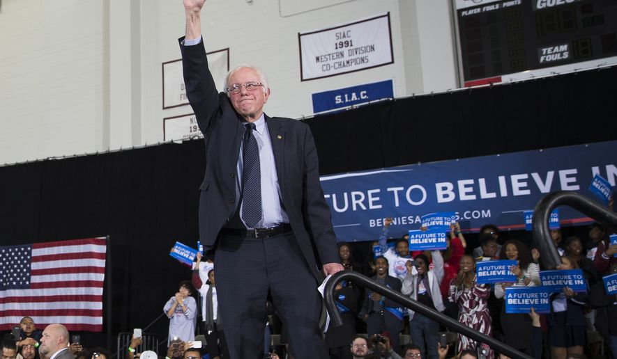 Democratic presidential candidate Sen. Bernie Sanders, I-Vt., pumps his fist during a rally at Morehouse College, on Tuesday, Feb. 16, 2016, in Atlanta. (AP Photo/Evan Vucci)