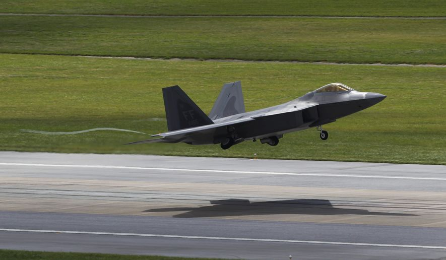 A U.S. Air Force F-22 Raptor stealth fighter takes off from Kadena Air Base on the southern island of Okinawa in Japan. (Associated Press)