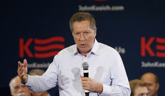 Republican presidential candidate, Ohio Gov. John Kasich meets with supporters during a town hall meeting, Tuesday, Feb. 16, 2016, in Livonia, Mich. (AP Photo/Carlos Osorio)
