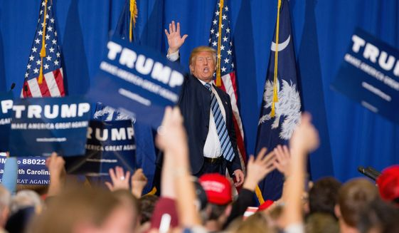 Republican presidential candidate Donald Trump waves after speaking at a rally at the Riverview Park Activity Center in North Augusta, S.C., Tuesday, Feb. 16, 2016. (AP Photo/Andrew Harnik)