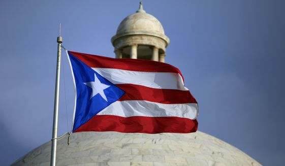 FILE - In this Wednesday, July 29, file 2015 photo, the Puerto Rican flag flies in front of Puerto Rico's Capitol as in San Juan, Puerto Rico. Legislators in Puerto Rico have approved on Monday, Feb. 15, 2016, a last-minute bill needed to finalize a deal to restructure the U.S. territory's heavily indebted public power company. (AP Photo/Ricardo Arduengo, File)