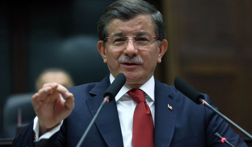 "Turkish Prime Minister Ahmet Davutoglu addresses his lawmakers in Ankara, Turkey, Tuesday, Feb. 16, 2016. Turkish artillery continue to pound the positions in northern Syria as a Turkish official says his country is pushing the case for ground operations in Syria, hoping for the involvement of the U.S. and other allies in an international coalition against the Islamic State group.The official told reporters in Istanbul that ""without ground operations it is impossible to stop the fighting in Syria"" and that Turkey has pressed the issue in recent discussions with the U.S. and other Western nations.(AP Photo)"