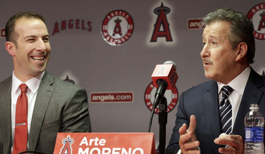 FILE - In this Oct. 5, 2015, file photo, Los Angeles Angels owner Arte Moreno, right, talks during a news conference announcing longtime Yankees executive Billy Eppler, left, as the new Angels general manager in Anaheim, Calif. Although the Los Angeles Angels made a few tweaks up and down their roster, they're headed into spring hoping for better results from largely the same players. (AP Photo/Nick Ut, File)