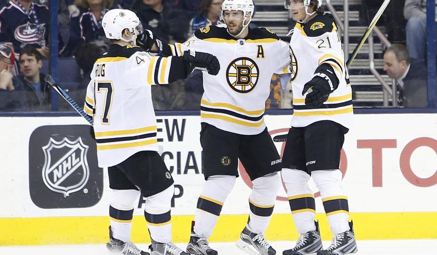 Boston Bruins' Loui Eriksson, right, of Sweden, celebrates his game-winning goal against the Columbus Blue Jackets with teammates Torey Krug, left, and David Krejci, of the Czech Republic, during the overtime period of an NHL hockey game Tuesday, Feb. 16, 2016, in Columbus, Ohio. The Bruins beat the Blue Jackets 2-1 in overtime. (AP Photo/Jay LaPrete)
