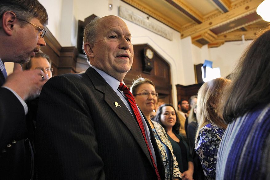 CORRECTS SECOND REFERENCE TO GRUENBERG - Alaska Gov. Bill Walker stands with a crowd in the Speaker of the House's chambers where a group gathered to memorialize Rep. Max Gruenberg on Tuesday, Feb. 16, 2016, in Juneau, Alaska. Gruenberg died suddenly on Sunday. (AP Photo/Rashah McChesney)