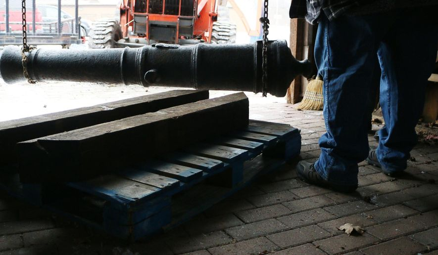 In this Feb. 12, 2016, photo, a Revolutionary War-era cannon is loaded into storage at the Coe House Museum, in Grass Lake, Mich. The Jackson Citizen Patriot reports that the 1,200-pound cannon, that spent about 200 years at the bottom of the Detroit River, is on renewable loan from the Detroit Historical Society. The Grass Lake Area Historical Connections plans to showcase the cannon as part of the group's Michigan Military Heritage Museum. The group wants to build a replica carriage for the cannon with white oak. (Taylor Irby/Jackson Citizen Patriot-MLive Media Group via AP) LOCAL STATIONS OUT; LOCAL INTERNET OUT; MANDATORY CREDIT
