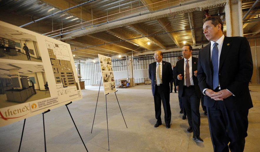 FILE - In this Thursday, Feb. 11, 2016, file photo, New York Gov. Andrew Cuomo, right, tours the future site of the new Athenex manufacturing facility with Athenex CEO Johnson Y. N. Lau, left, and COO and CFO Flint D. Besecker, center, in Dunkirk, N.Y. On Tuesday, Feb. 16, the Federal Reserve of New York releases its February survey of manufacturers. (Derek Gee/Buffalo News via AP, Pool, File)