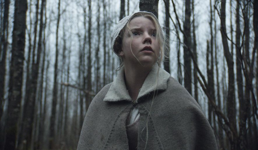"""This photo provided by courtesy of A24 shows Anya Taylor-Joy as Thomasin  in a scene from the film, """"The Witch."""" (Rafy/A24 via AP)"""
