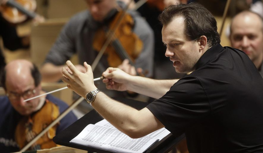 "FILE- In this Nov. 20, 2014, file photo, Boston Symphony Orchestra music director Andris Nelsons rehearses at Symphony Hall in Boston. The BSO and musical director Andris Nelsons won the orchestral performance prize for ""Shostakovich Under Stalin's Shadow,"" on Monday, Feb. 15, 2016. It was the orchestra's first recording in a new partnership with the Deutsche Grammophon label, and its seventh Grammy overall. (AP Photo/Steven Senne, File)"