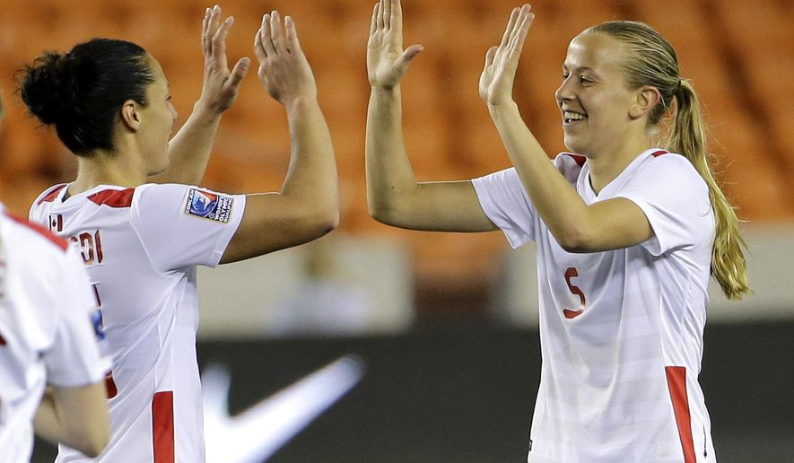 Canada's Rebecca Quinn (5) celebrates with Canada's Melissa Tancredi after scoring a goal against Guatemala during the second half of a CONCACAF Olympic qualifying tournament soccer match Tuesday, Feb. 16, 2016, in Houston. Canada won 10-0. (AP Photo/David J. Phillip)