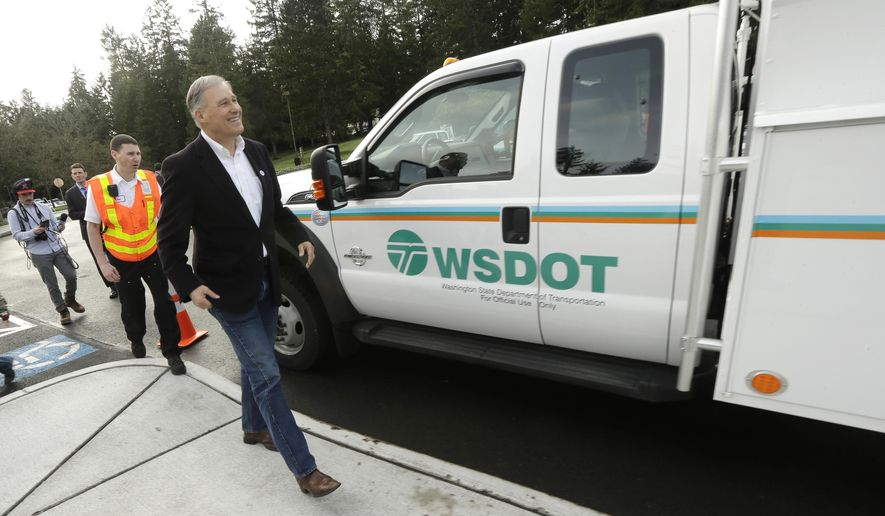 Washington Gov. Jay Inslee walks past an incident response vehicle before speaking Tuesday, Feb. 16, 2016, at a Dept. of Transportation facility in Shoreline, Wash. Inslee announced changes to the Interstate 405 express lane tolling system Tuesday and talked about his plan to ask the Legislature approve new incident response teams for Interstate 5 to quickly clear collisions and provide roadside assistance to motorists. (AP Photo/Ted S. Warren)