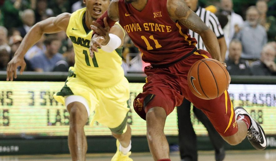 Baylor's Lester Medford, left, fouls Iowa State's Monte Morris (11) as Morris drives to the basket in the first half of an NCAA college basketball game, Tuesday, Feb. 16, 2016, in Waco, Texas. (AP Photo/Tony Gutierrez)