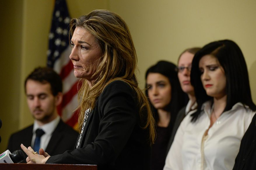 A tearful Christine Stenquist, who has said she has a brain tumor, speaks out in support for Senate Bill 73, the proposal to legalize medical marijuana, as she is joined by numerous patients suffering from severe pain and ailments with few treatment options, Tuesday, Feb. 16, 2016, in Salt Lake City. (Francisco Kjolseth/The Salt Lake Tribune via AP)