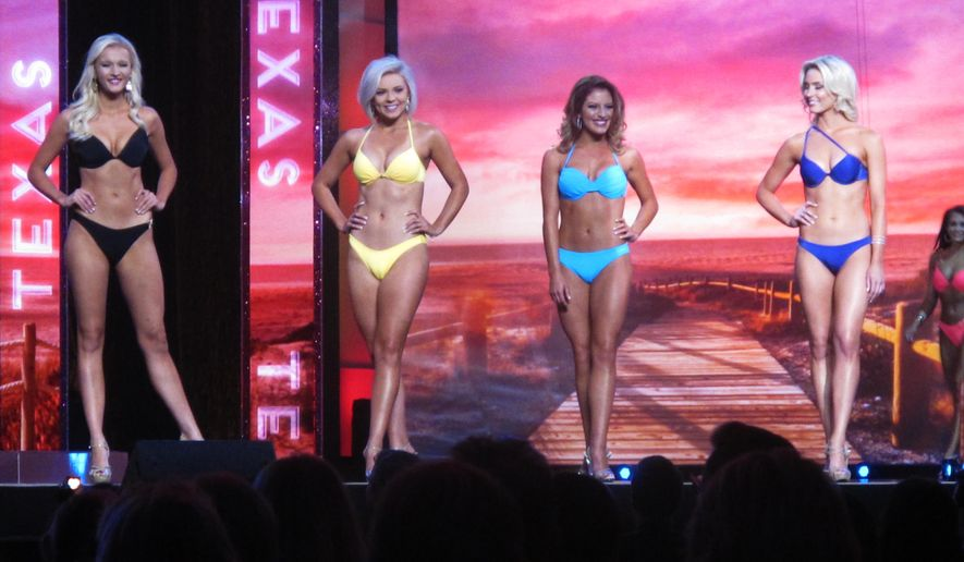 In this Sept. 8, 2015 photo, contestants pose in the swimsuit competition of the Miss America pageant in Atlantic City, N.J. (AP Photo/Wayne Parry) *FILE*