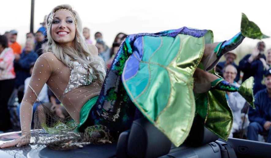 FILE - In this Sept. 14, 2013 file photo Miss New Jersey Cara McCollum displays her shoes during the Miss America Shoe Parade at the Atlantic City, N.J. boardwalk. McCollum was critically injured when her convertible spun off a highway and hit a tree, state police said Tuesday. (AP Photo/Julio Cortez, File)