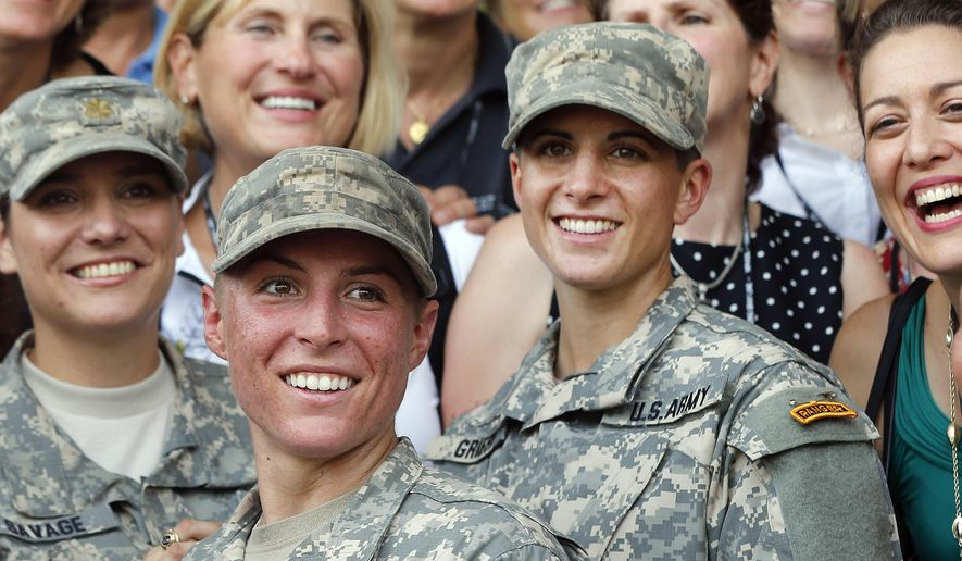 In this Aug. 21, 2015, file photo, Army 1st Lt. Shaye Haver, center, and Capt. Kristen Griest, right, pose for photos with other female West Point alumni after an Army Ranger school graduation ceremony at Fort Benning, Ga. (AP Photo/John Bazemore, File)