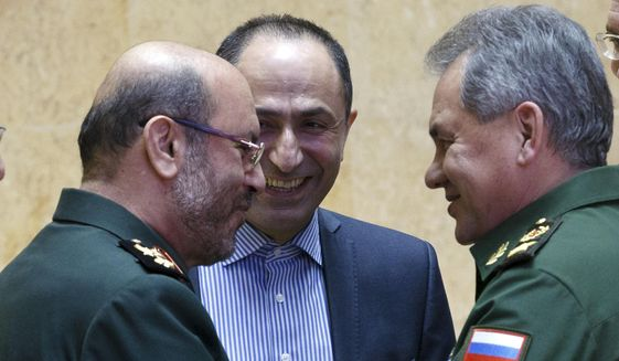 Russian Defense Minister Sergei Shoigu, right, and Iranian Defense Minister Hossein Dehghan shake hands during their meeting in Moscow, Russia, Tuesday, Feb. 16, 2016.  The Iranian defense minister is visiting Moscow for talks about closer military cooperation. (Vadim Savitsky/ Russian Defense Ministry Press Service pool photo via AP)