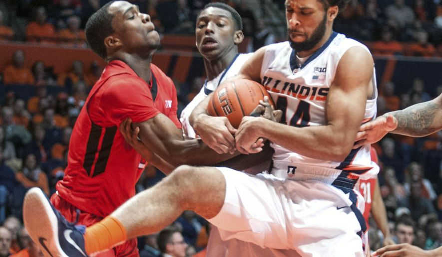 Illinois' guard Alex Austin (44) and Rutgers' guard Mike Williams (5) struggle over the ball as Illinois' guard Jalen Coleman-Lands (5) looks on in the second half of the NCAA college basketball game at State Farm Center in Champaign, Ill on Tuesday, Feb. 16, 2016.  Illinois won 82-66. (AP Photo/Heather Coit)