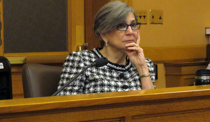 Kansas Senate President Susan Wagle, R-Wichita, listens to testimony during a committee hearing, Tuesday, Feb. 16, 2016, at the Statehouse in Topeka, Kan. More than 40 fellow GOP legislators have asked Wagle to reverse her decision to remove the Senate health committee's chairwoman. (AP Photo/John Hanna)