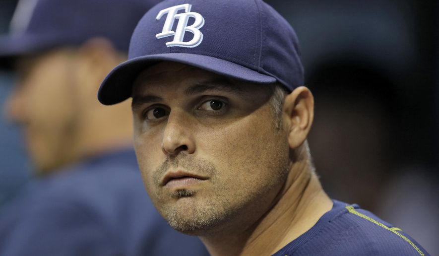 FILE - In this Sept. 29, 2015, file photo, Tampa Bay Rays manager Kevin Cash looks on during the first inning of an interleague baseball game against the Miami Marlins,  in St. Petersburg, Fla. Second-year manager Kevin Cash will spend training trying to determine how all the new bats fit best. (AP Photo/Chris O'Meara, File)
