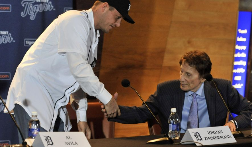 FILE - In this Nov. 30, 2015, file photo, Detroit Tigers pitcher Jordan Zimmermann shakes hands with Tigers owner Mike Ilitch, right, during the news conference in Detroit. An offseason of big spending may put the Detroit Tigers back in contention after a last-place finish in 2015. (Robin Buckson/Detroit News via AP, File)  DETROIT FREE PRESS OUT; HUFFINGTON POST OUT; MANDATORY CREDIT