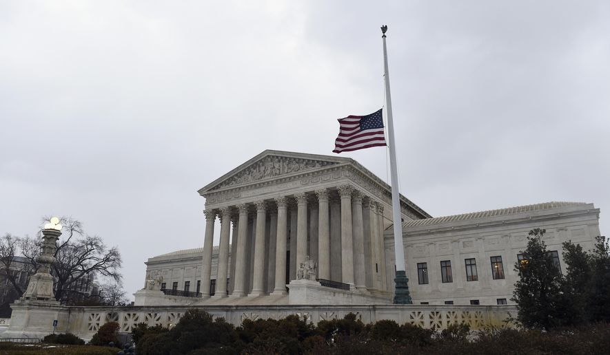 The flag flies at half-staff outside the Supreme Court in Washington, Tuesday, Feb. 16, 2016, following the death of Supreme Court Justice Antonin Scalia over the weekend. (AP Photo/Susan Walsh) ** FILE **