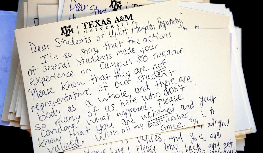 This Monday, Feb. 15, 2016, photo shows a letter addressed to visiting students from Uplift Hampton Preparatory sits atop a stack of similar notes at Texas A&M University in College Station, Texas. Texas A&M University System Chancellor John Sharp apologized Tuesday to high school students for racial insults that some minority students say they heard while visiting the College Station campus last week. (Dave McDermand/College Station Eagle via AP) MANDATORY CREDIT