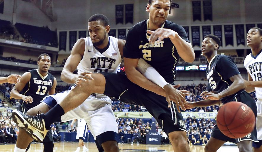 Pittsburgh's Sheldon Jeter (21) and Wake Forest's Devin Thomas (2) battle for a rebound as the ball gets away during the first half of an NCAA college basketball game, Tuesday, Feb. 16, 2016, in Pittsburgh. (AP Photo/Keith Srakocic)
