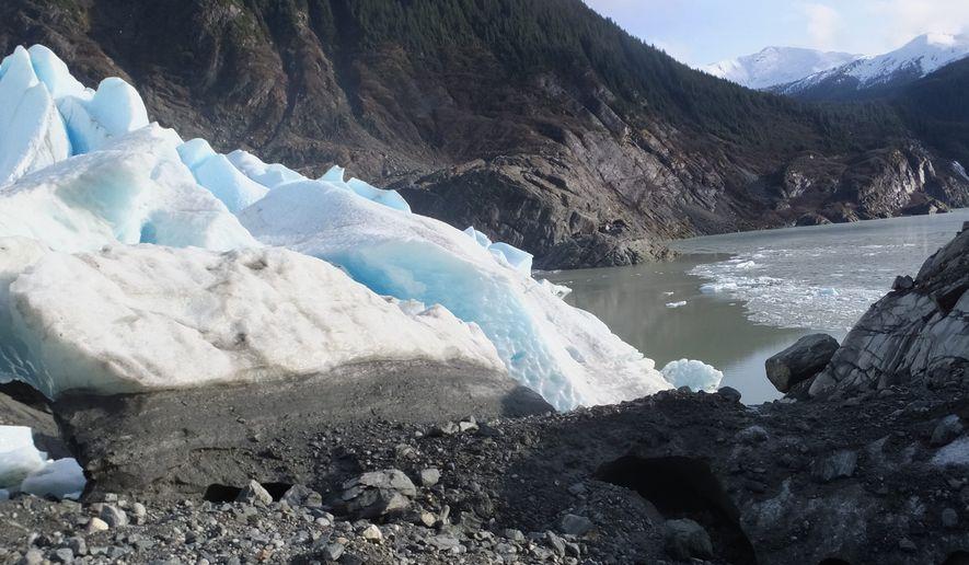 Ice from Mendenhall Glacier spills alongside sediment and rocks in Juneau, Alaska. (Associated Press)
