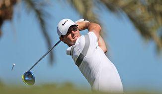 Rory McIlroy of Northern Ireland tees off on the 3rd hole  during 3rd round of the Dubai Desert Classic golf tournament in Dubai, United Arab Emirates, Saturday, Feb. 6, 2016. (AP Photo/Kamran Jebreili)