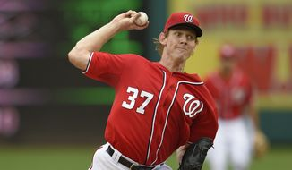 Washington Nationals starting pitcher Stephen Strasburg (37) delivers a pitch against the Philadelphia Phillies during a baseball game, Saturday, Sept. 26, 2015, in Washington. The Nationals won 2-1 in 12 innings. (AP Photo/Nick Wass)