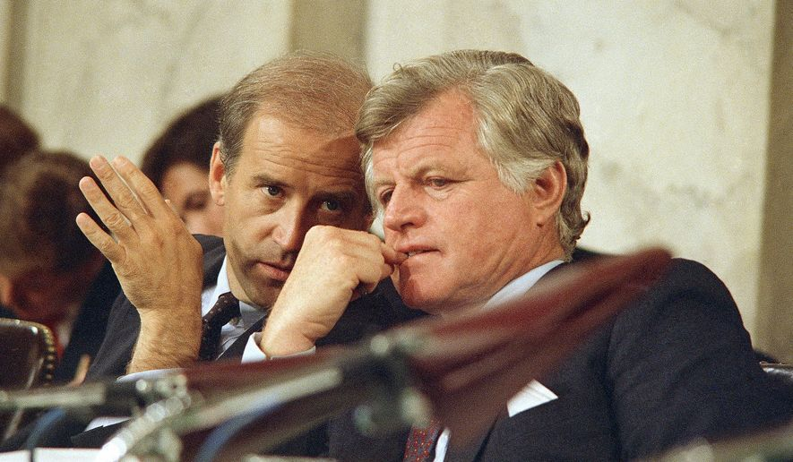 Senate Judiciary Chairman Joseph Biden (left) speaks with Sen. Edward Kennedy during confirmation hearings for Supreme Court nominee Robert H. Bork on Sept. 16, 1987. (Associated Press)