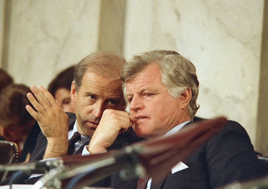 Senate Judiciary Chairman Joseph Biden (left) speaks with Sen. Edward Kennedy during confirmation hearings for Supreme Court nominee Robert H. Bork on Sept. 16, 1987. (Associated Press)