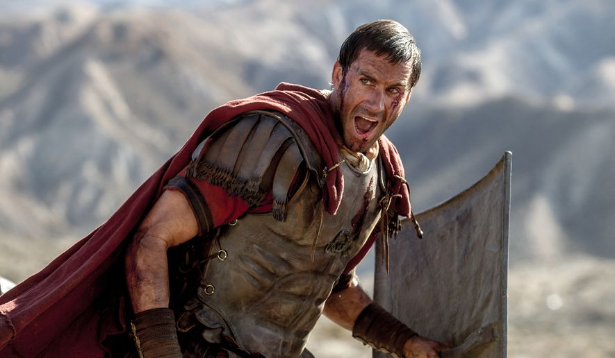 """In this image provided by Columbia Pictures, Joseph Fiennes as Clavius leads his Roman soldiers during the zealot battle in Columbia Pictures' """"Risen."""" The movie opens in U.S. theaters nationwide Feb. 19, 2016. (Rosie Collins/Columbia Pictures via AP)"""