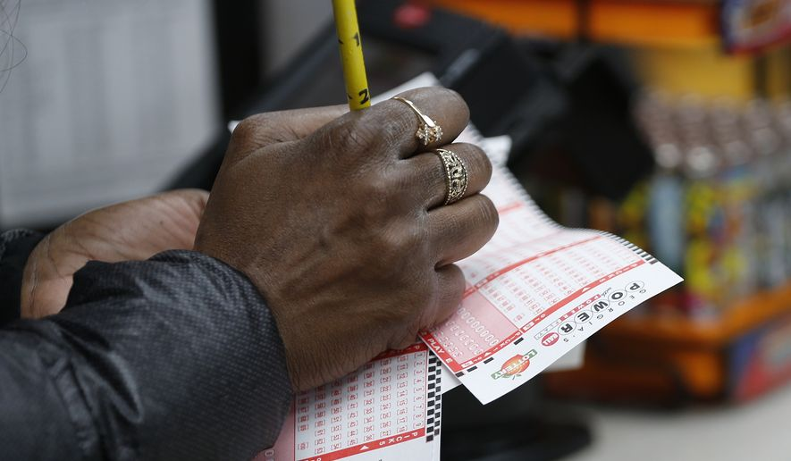 A lottery player waits in line to purchase tickets for The Power Ball drawing at a Pilot convenience store  Wednesday, Jan. 13, 2016, in Tallpoosa, Ga . (AP Photo/John Bazemore)