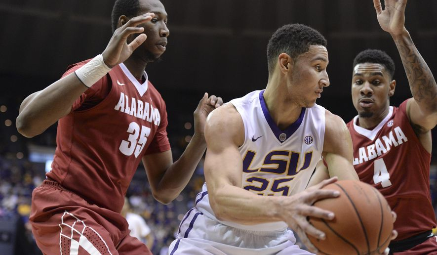 LSU forward Ben Simmons (25) looks to maneuver the ball away from Alabama forward Donta Hall (35) and Alabama guard Arthur Edwards (4) in the first half of their NCAA college basketball game in Baton Rouge, La., Wednesday, Feb. 17, 2016. (Hilary Scheinuk/The Advocate via AP)  MAGS OUT; INTERNET OUT; NO SALES; TV OUT; NO FORNS; LOUISIANA BUSINESS INC. OUT (INCLUDING GREATER BATON ROUGE BUSINESS REPORT, 225, 10/12, INREGISTER, LBI CUSTOM); MANDATORY CREDIT