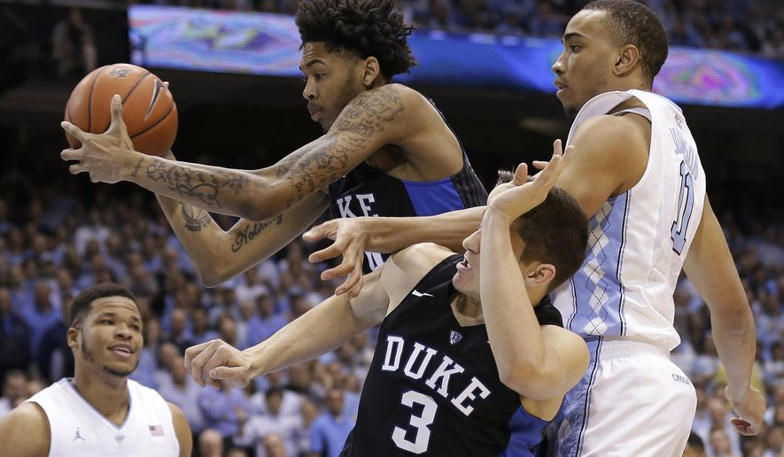 Duke's Brandon Ingram reaches for the ball with Grayson Allen (3) as North Carolina's Brice Johnson, right, and Kennedy Meeks, left, defend during the first half of an NCAA college basketball game in Chapel Hill, N.C., Wednesday, Feb. 17, 2016. (AP Photo/Gerry Broome)