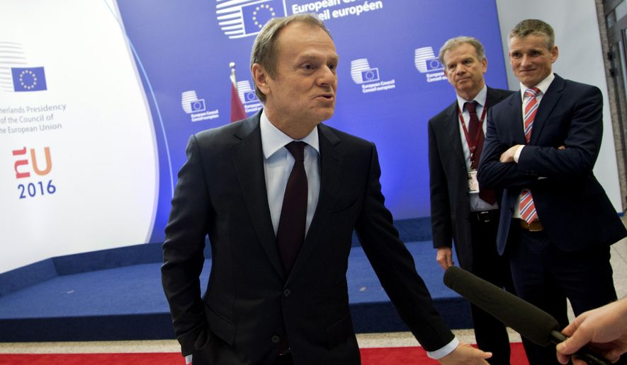 European Union President Donald Tusk speaks with journalists as he arrives at the European Council building in Brussels on Wednesday, Feb. 17, 2016. (AP Photo/Virginia Mayo) ** FILE **