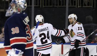 Chicago Blackhawks Andrew Desjardins (11) is congratulated by Phillip Danault (24) after scoring a goal on New York Rangers goalie Henrik Lundqvist (30) during the first period of an NHL hockey game, Wednesday, Feb. 17, 2016, in New York. (AP Photo/Adam Hunger)