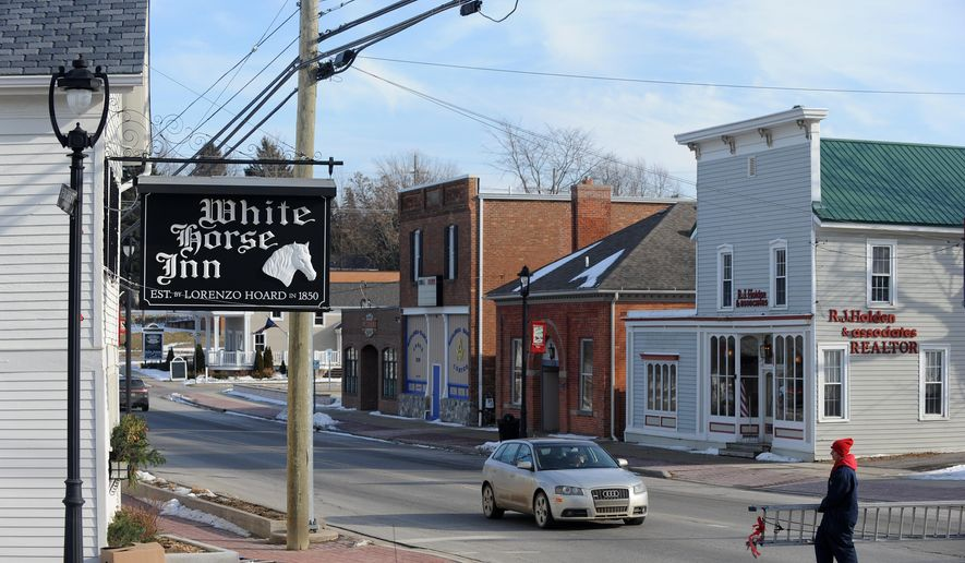 This Jan. 25, 2016, photo shows the the White Horse Inn established in 1850 in downtown Metamora in Metamora, Mich. The Boy Scouts' Michigan Crossroads Council, along with American Aggregates of Michigan, applied in November for a zoning change that would allow mining at a scout camp located a mile from the village of Metamora in southern Lapeer County, The Detroit News reported. (Brandy Baker/Detroit News via AP)  DETROIT FREE PRESS OUT; HUFFINGTON POST OUT; MANDATORY CREDIT