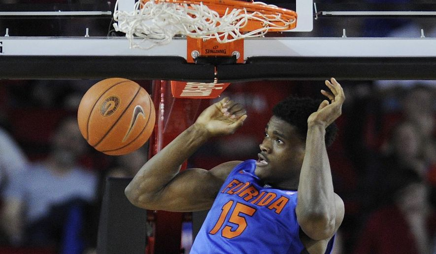 Florida center John Egbunu dunks during the second half of an NCAA college basketball game against Georgia on Tuesday, Feb. 16, 2016, in Athens, Ga. Florida won 57-53. (AJ Reynolds/Athens Banner-Herald via AP)