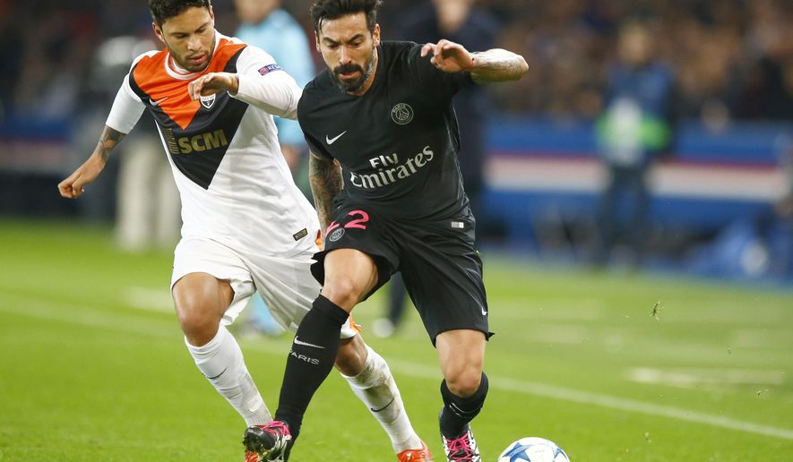 FILE  - This is a Tuesday, Dec. 8, 2015 file photo of PSG's Ezequiel Lavezzi, right, as he goes past  Shakhtar's, Marlos during the Champions League Group A soccer match between PSG and FC Shakhtar Donetsk at the Parc des Princes stadium in Paris. Chinese Super League club Hebei China Fortune said Wednesday Feb. 17, 2016 that it has signed Paris Saint-Germain's Ezequiel Lavezzi, making him the latest player to be lured from a European club by one of China's big-spending outfits.  (AP Photo/Francois Mori, File)