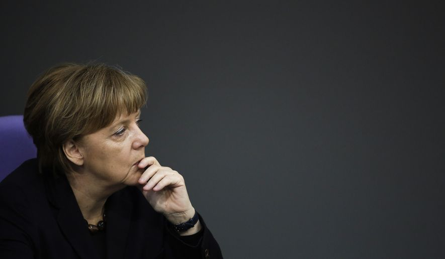 German Chancellor Angela Merkel listens to the debate after her speech a day before an EU council meeting, at the German parliament Bundestag in Berlin, Germany, Wednesday, Feb. 17, 2016. Merkel said that it's in Germany's national interest for Britain to remain in the European Union, and pressed her fellow European leaders to work with Turkey to curb the migrant influx. (AP Photo/Markus Schreiber)