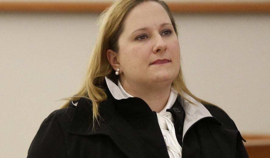 In this Feb. 8, 2016 photo, former New York City corrections officer Carol Lackner appears in court in New York. Lackner, who was arrested after a mentally ill inmate died in a stifling 101-degree cell on Rikers Island in 2014, has pleaded guilty to falsifying logbook entries saying she checked on him. She was sentenced to five years of probation. (AP Photo/Seth Wenig)