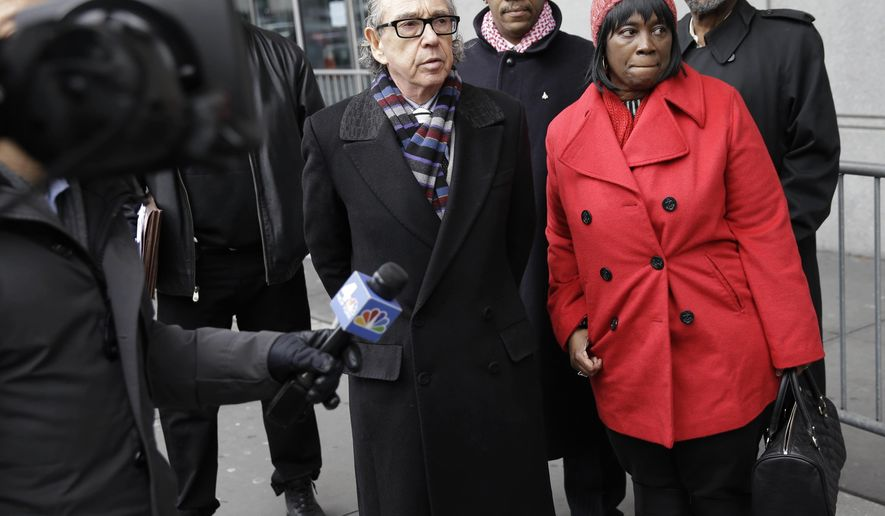 Margaret Burton, mother of Jahmal Lightfoot, and her attorney Sanford Rubinstein, left, speak briefly to members of the media in front of a Bronx courthouse in New York, Wednesday, Feb. 17, 2016. As New York officials debate whether to close down Rikers Island, the city's famous jail complex, several New York City correction officers are about to stand trial on charges that they savagely beat Lightfoot, an inmate, after he stared down an assistant warden. (AP Photo/Seth Wenig)