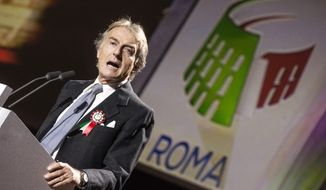 """Rome 2024 Olympic bid committee chairman Luca Cordero di Montezemolo speaks during the presentation of Rome's bid to stage the 2024 Olympics, in Rome, Wednesday, Feb 17, 2016, the same day the initial bid dossier was submitted to the International Olympic Committee. At an extravagant presentation Wednesday produced by the same company handling the ceremonies for the upcoming Olympics in Rio de Janeiro, Rome organizers revealed their bid theme _ """"The Italian art of the welcome.""""  (Angelo Carconi/ANSA via AP Photo) ITALY OUT"""