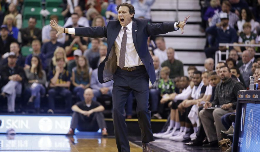 FILE - In this Nov. 7, 2015, file photo, Utah Jazz coach Quin Snyder shouts to his team during the team's NBA basketball game against the Memphis Grizzlies in Salt Lake City. The Jazz are in position to make the playoffs for the first time since 2011-12 and finish above .500 for the first time since 2012-13. This would be the first time most of the roster and second-year coach Snyder as been in the playoffs. (AP Photo/Rick Bowmer, File)