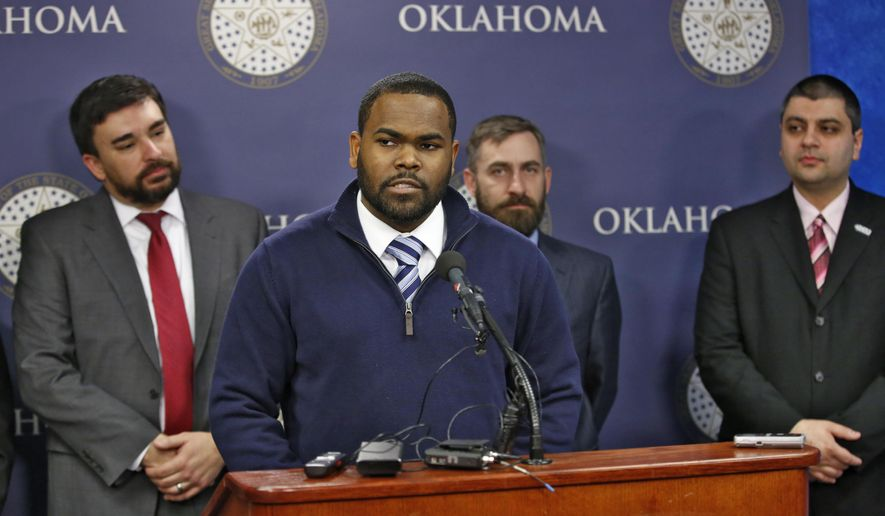 Raja'ee Fatihah speaks to members of the media at the state Capitol in Oklahoma City, Wednesday, Feb.  17, 2016. Fatihah, a U.S. Army reservist, who was asked to leave a gun range in Oklahoma after identifying himself as a Muslim is suing the owners in federal court, pushing back against what he says is a rise in anti-Islamic sentiment across the country. (Steve Gooch/The Oklahoman via AP) LOCAL STATIONS OUT (KFOR, KOCO, KWTV, KOKH, KAUT OUT); LOCAL WEBSITES OUT; LOCAL PRINT OUT (EDMOND SUN OUT, OKLAHOMA GAZETTE OUT) TABLOIDS OUT; MANDATORY CREDIT