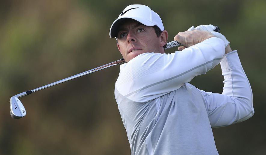 FILE - In this Thursday, Feb. 4, 2016 file photo, Rory McIlroy of Northern Ireland follows his ball on the 11th hole during 1st round of the Omega Dubai Desert Classic golf tournament in Dubai, United Arab Emirates. The road to the Masters starts on the other side of the country for Rory McIlroy.  McIlroy has heard enough of Riviera that he decided to play the Northern Trust Open for the first time, and 27 holes over the last two days have left him convinced that it was a smart move and that it was worth it to add one more event to a busy schedule, Wednesday, Feb. 17, 2016. (AP Photo/Kamran Jebreili, File)